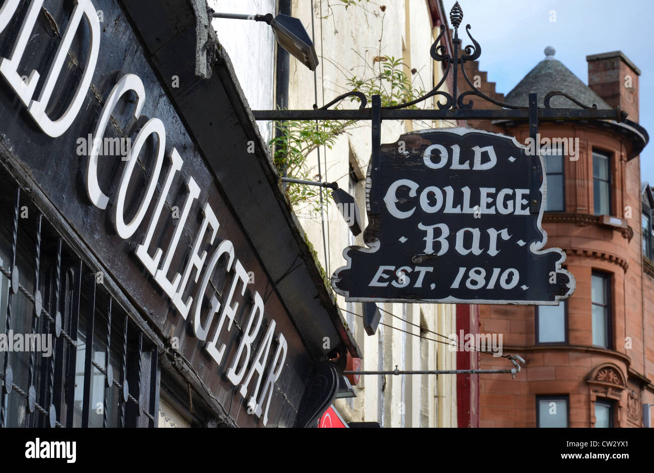 Sign outside the Old College Bar (est. 1810) on Glasgow's High Street on the edge of the Merchant City area. - Stock Image