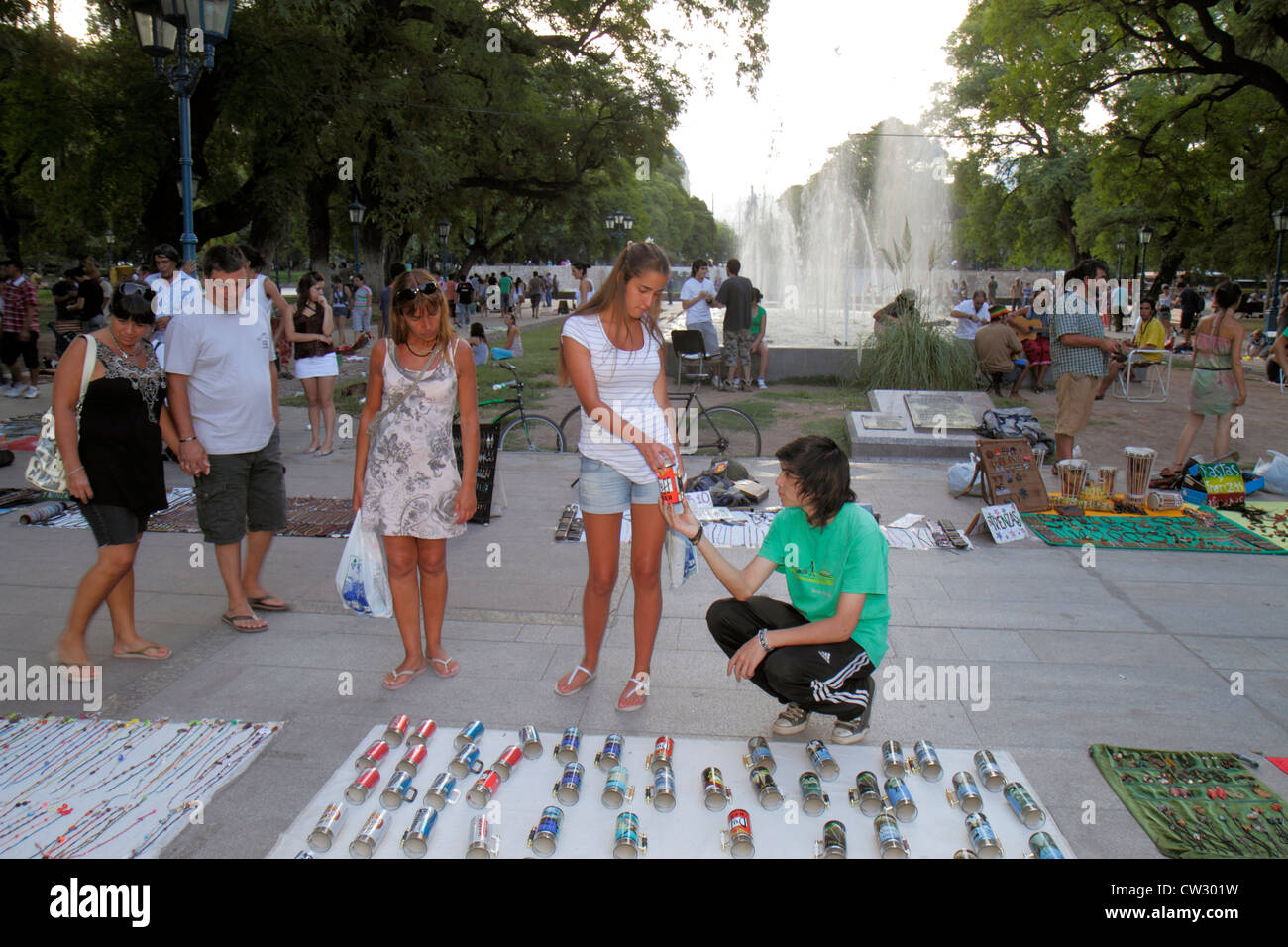Mendoza Argentina Plaza Independencia public park fountain green space crowd crowded stroll fountain vendor shopping - Stock Image