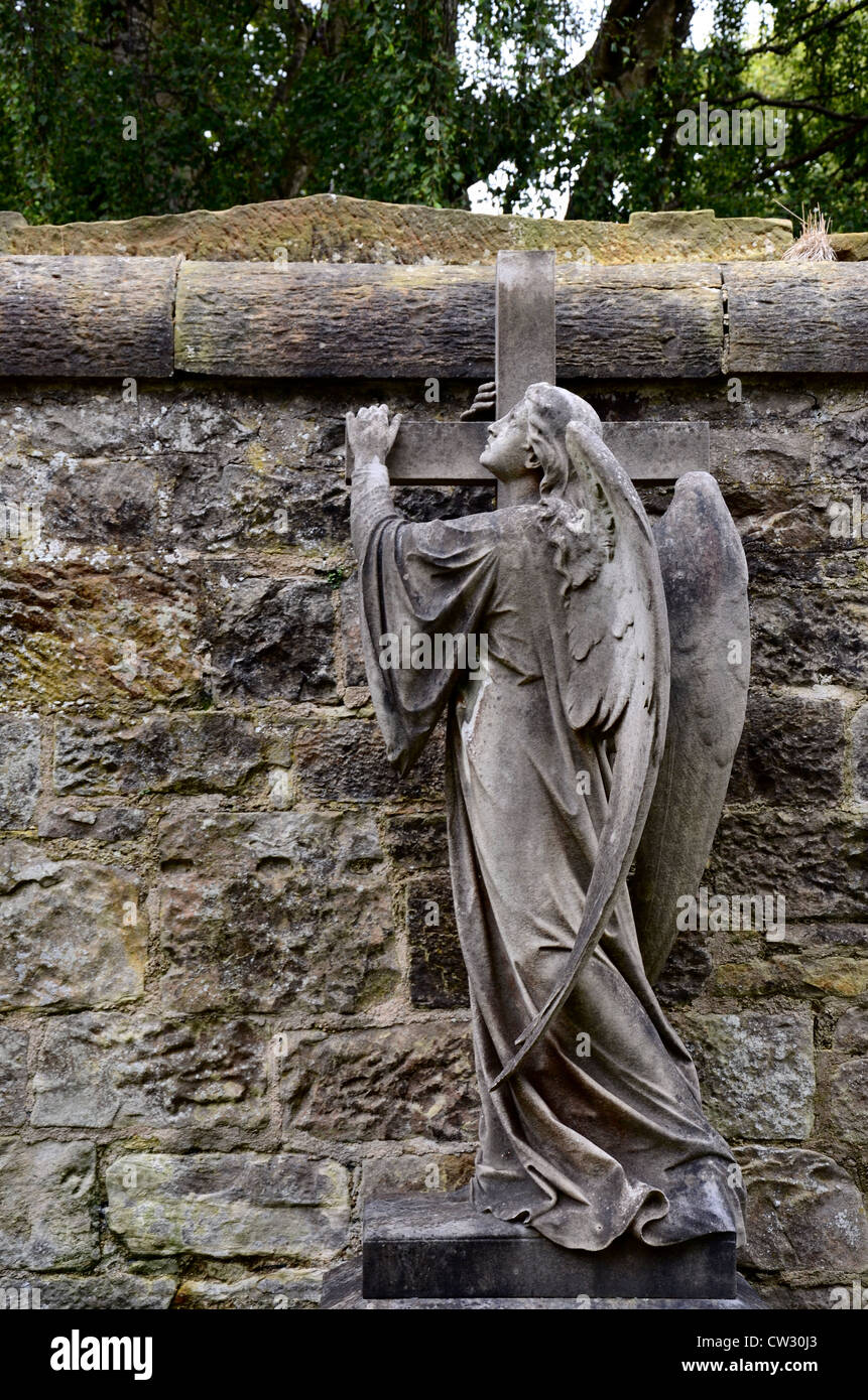 Statue of an angel holding on to a cross in the Dean