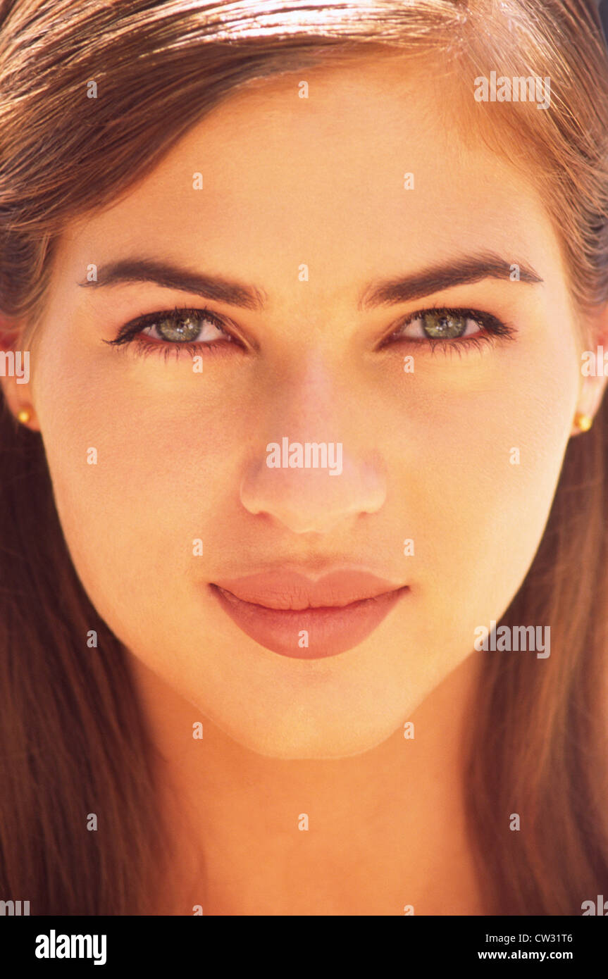 Beauty portrait of a young woman, early twenties, shot on location with available late afternoon light - Stock Image