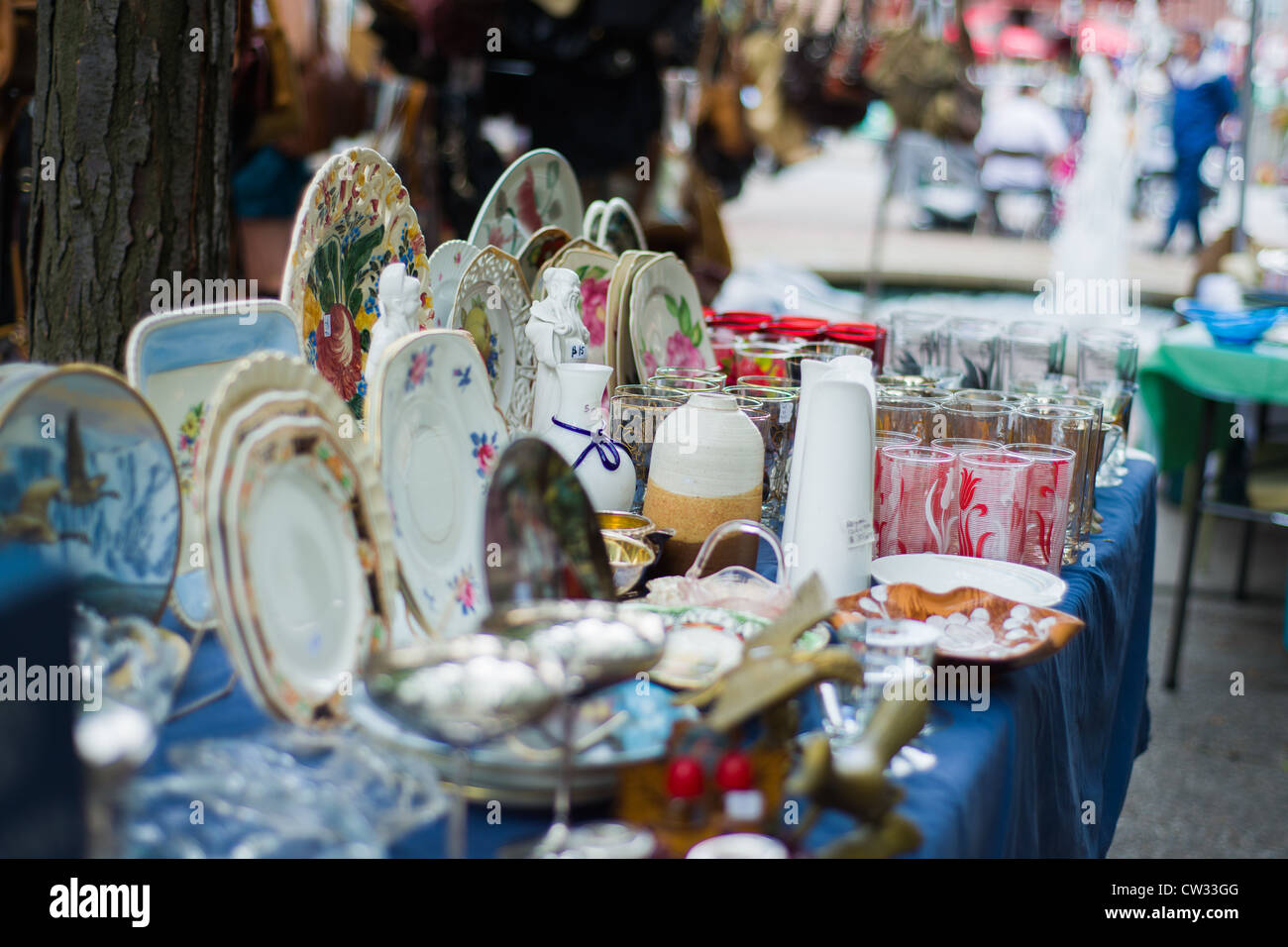 Antiques fair table of items. - Stock Image