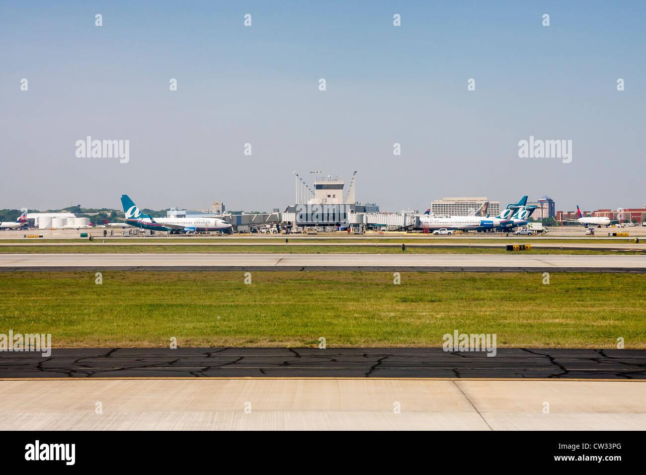 Airtran airplanes at gates at Atlanta Hartsfield Airport - Stock Image