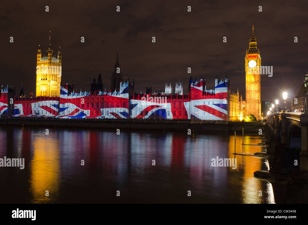 Houses of Parliament at night with London Olympics 2012 Union jack flag projection Uk - Stock Image
