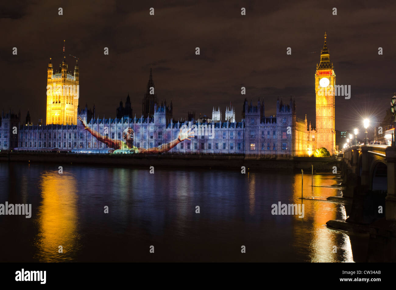 Houses of Parliament at night with London Olympics 2012 projection of Usain Bolt Jamaican athlete - Stock Image