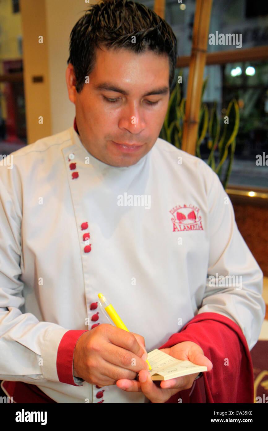 Buenos Aires Argentina Avenida de Mayo Pizza & Cafe Alameda restaurant dining Hispanic man dining waiter job uniform Stock Photo