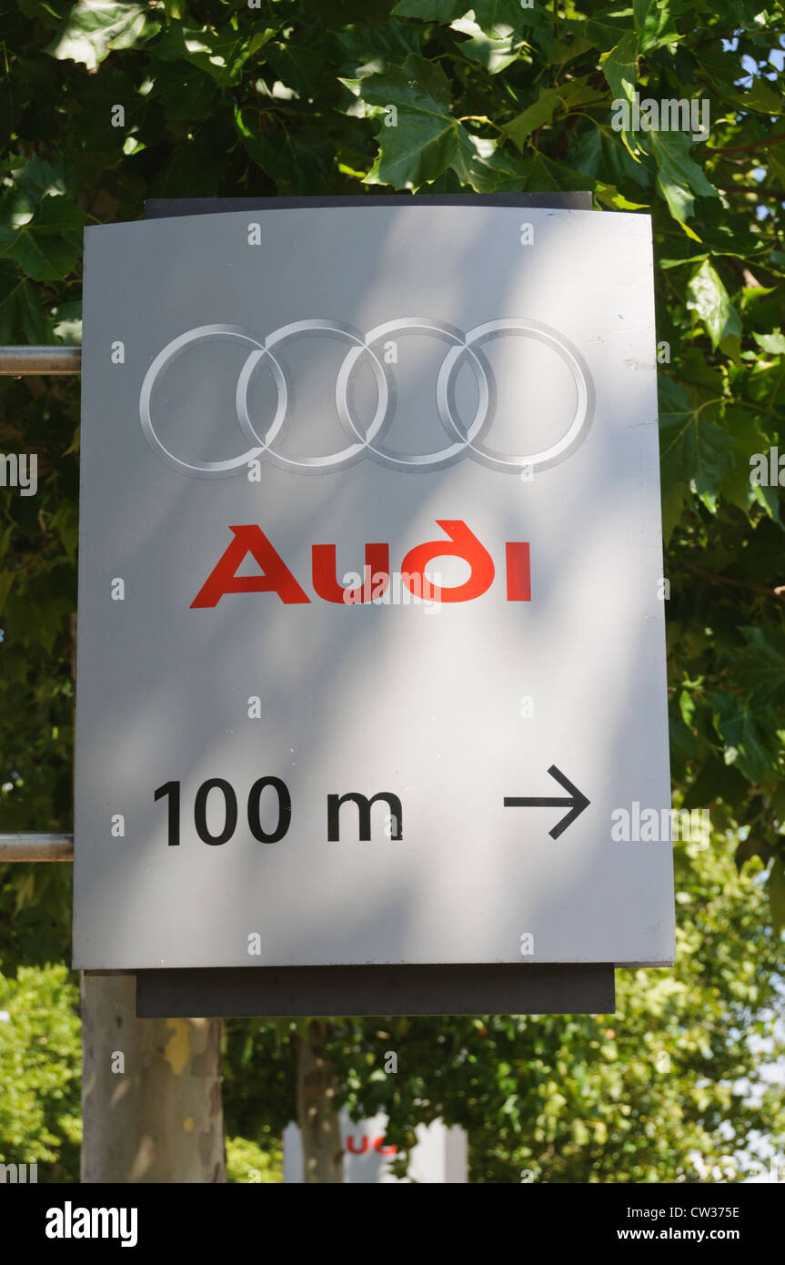 Audi car maker company logo on a street sign showing the way 100 meters to the right to an Audi car dealership Heilbronn - Stock Image