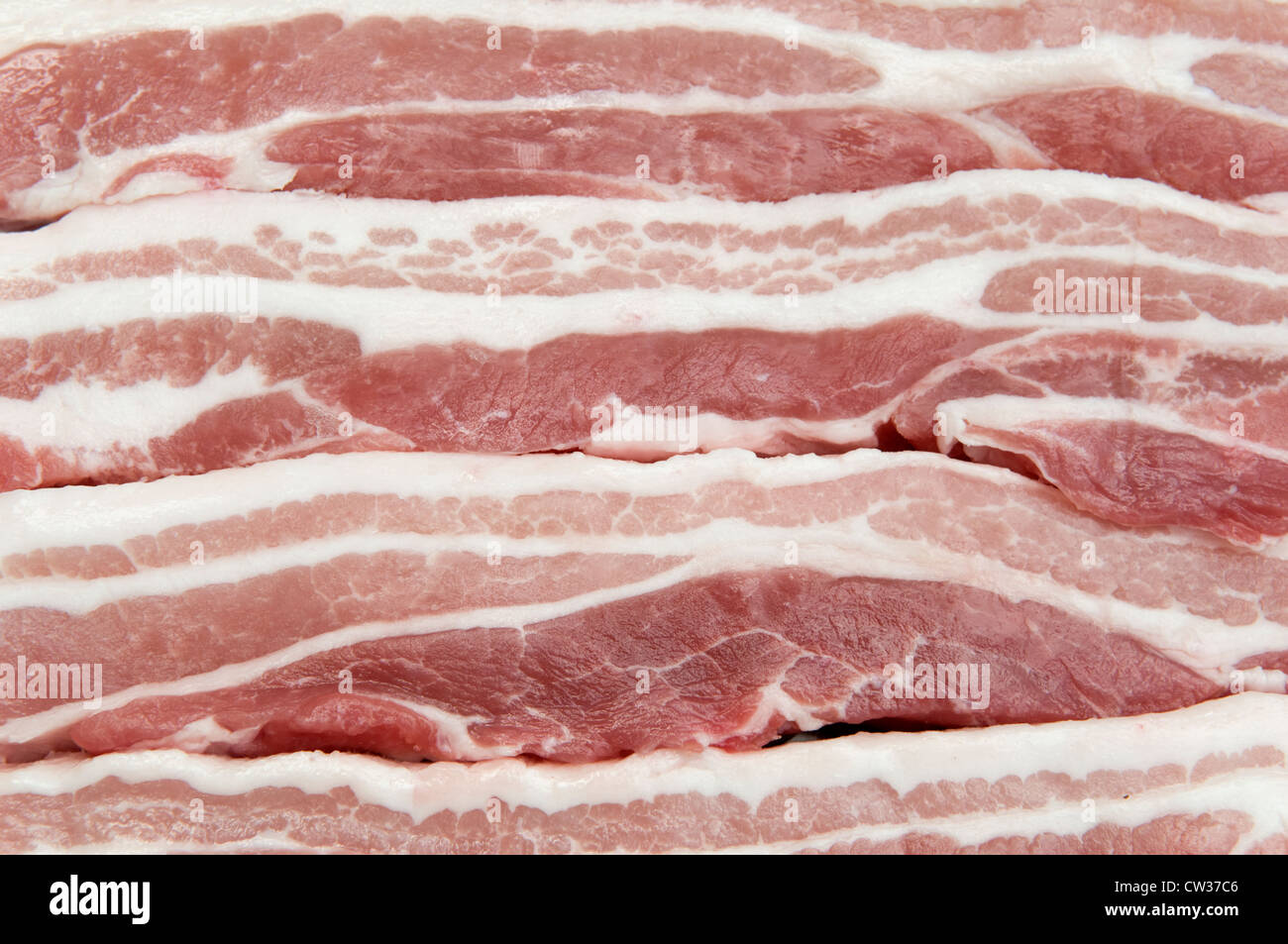 Rindless belly pork slices - Stock Image