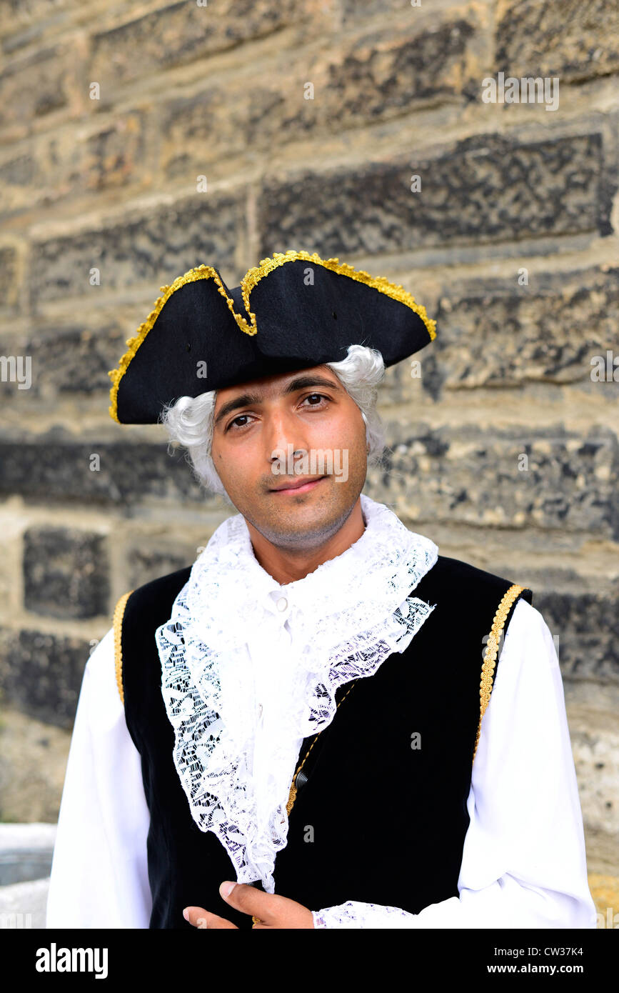 Dressed in an 17th-19th century style clothing. - Stock Image