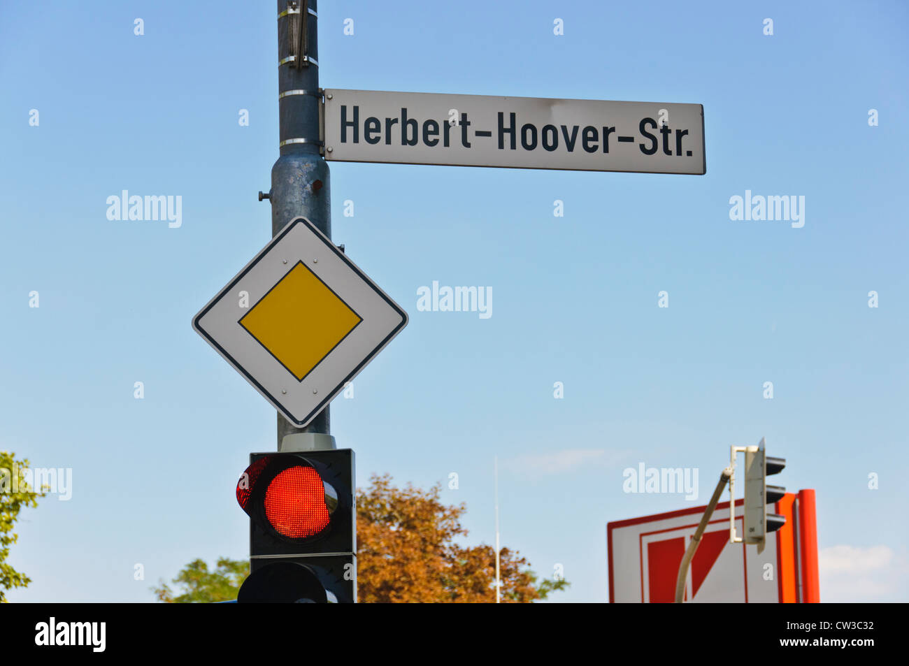 Herbert-Hoover-Str. street sign red traffic light GIVE WAY road sign yield sign - Heilbronn Germany Europe - Stock Image