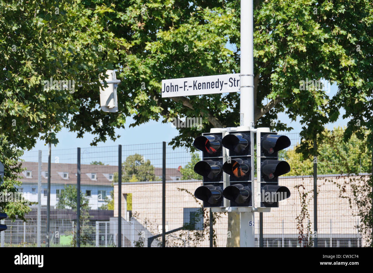 John-F.-Kennedy-Str street sign 2 traffic lights red and yellow - Heilbronn Germany Europe - Stock Image