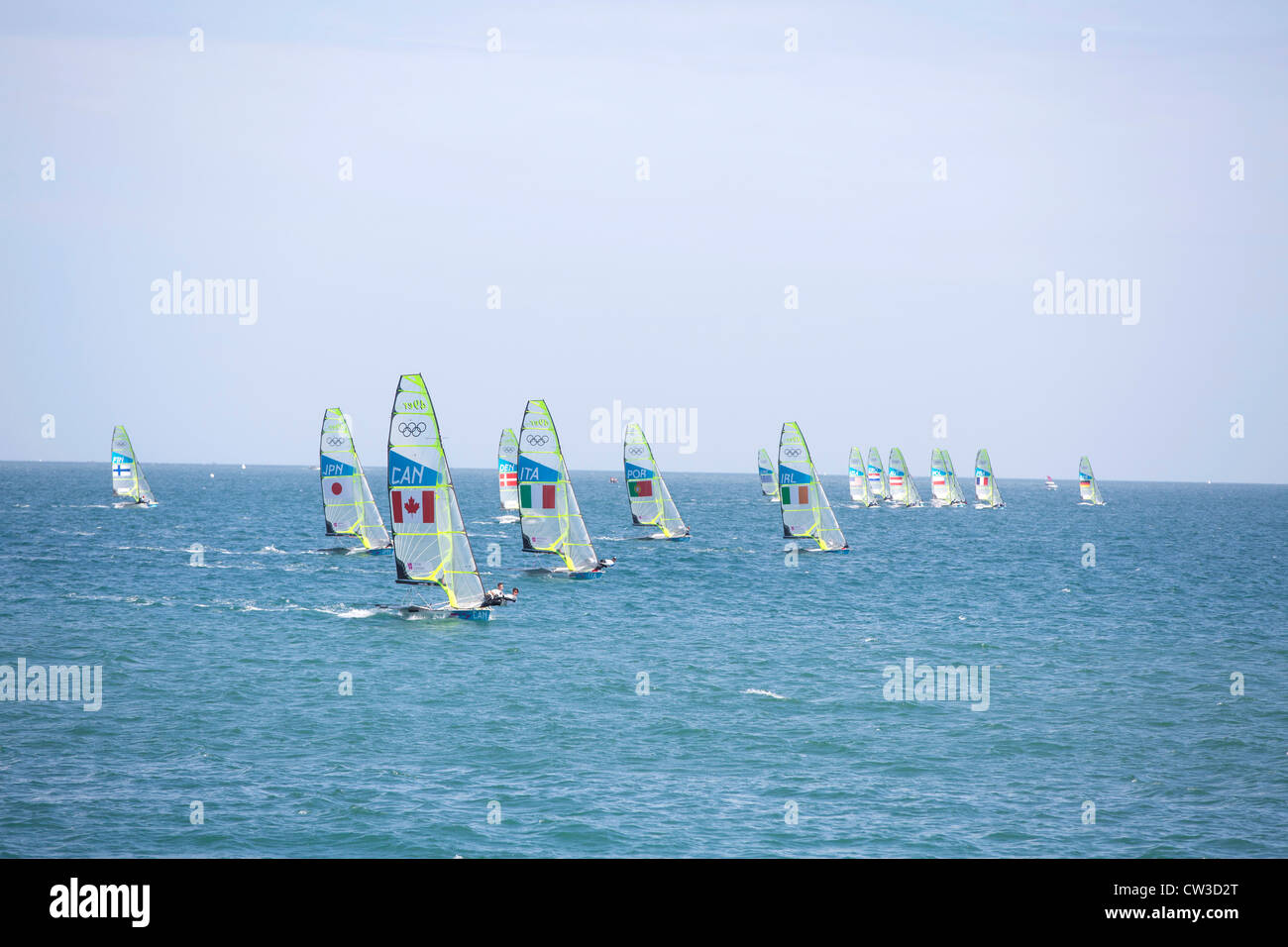 49er sailing dinghies racing during the Olympic sailing regatta in Weymouth and Portland - Stock Image