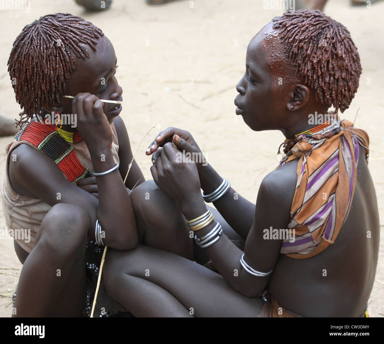 Africa, Ethiopia, Omo River Valley Hamer Tribe two young girls with ochre hair The hair is coated with ochre mud - Stock Image