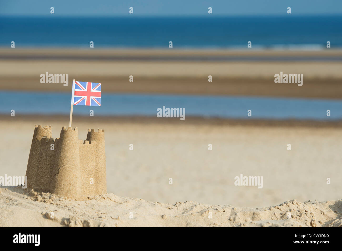 Union Jack flag in a sandcastle on a sand dune. Wells next the sea. Norfolk, England - Stock Image
