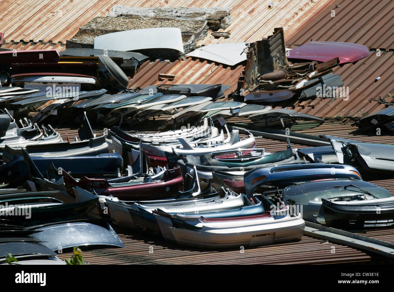 Automobile bumpers at a junkyard for used car parts Stock Photo ...