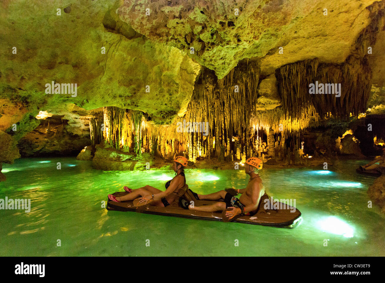 couple river rafting in a cenote at Xplor Adventure Park - Stock Image