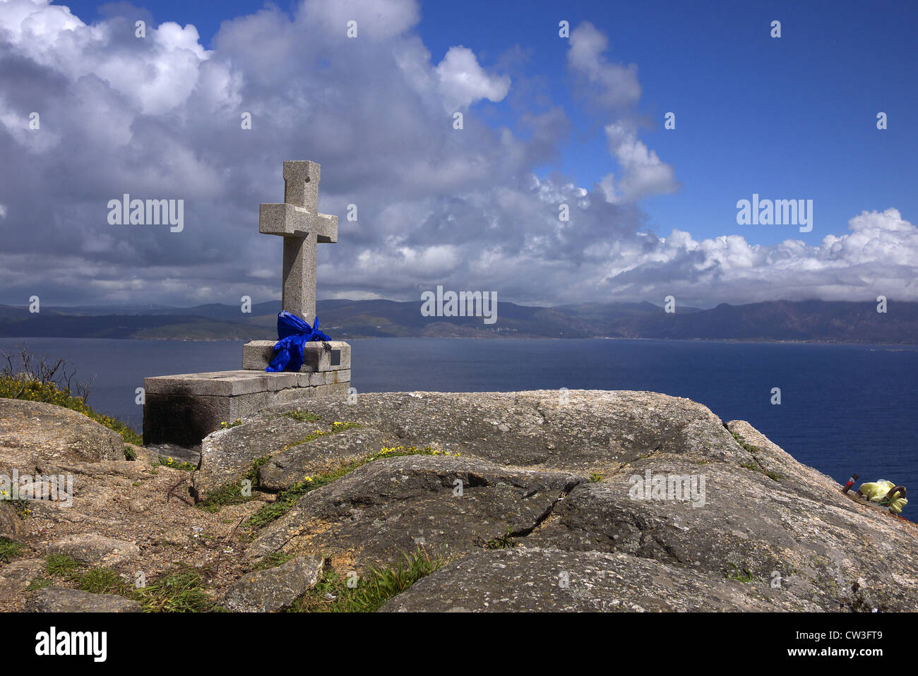 A memorial on the rocks at Finisterre in Spain, an extension of the pilgrim route to Santiago de Compostela. - Stock Image
