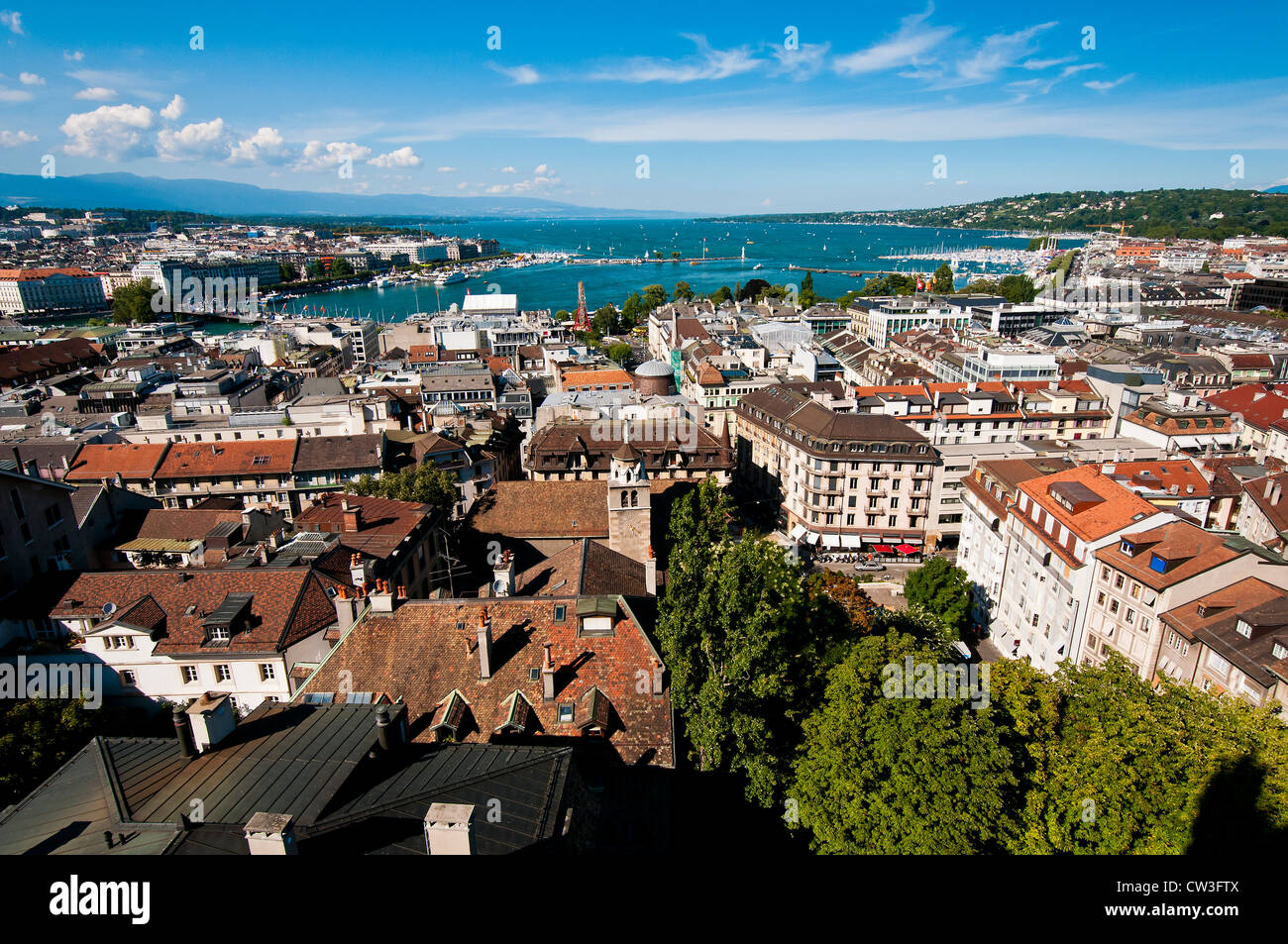 Panoramic view over city rooftops and Lake Geneva, Geneva, Switzerland - Stock Image