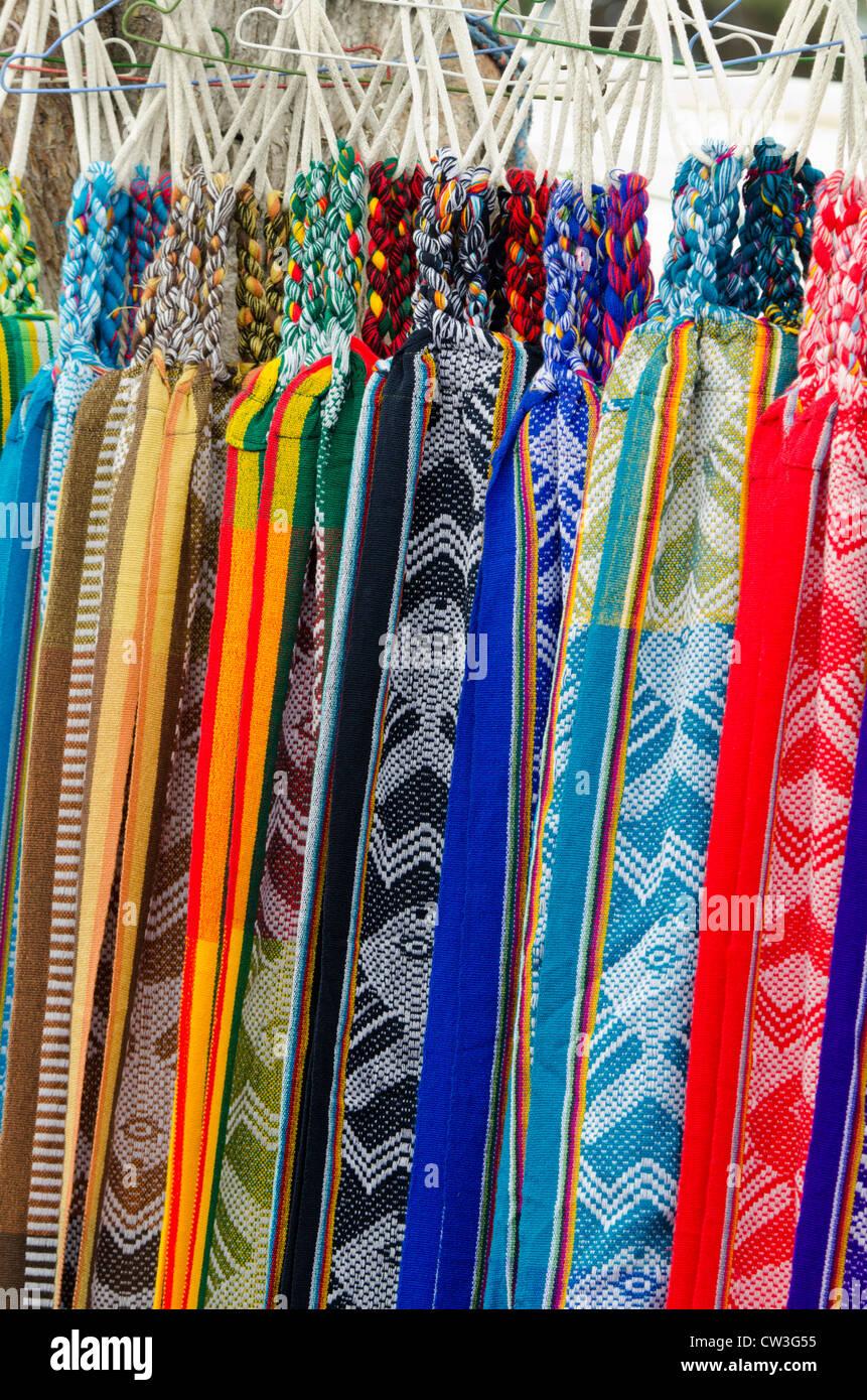 Ecuador, Quito area, Otavalo Handicraft Market. Traditional souvenir textile hammocks. Stock Photo