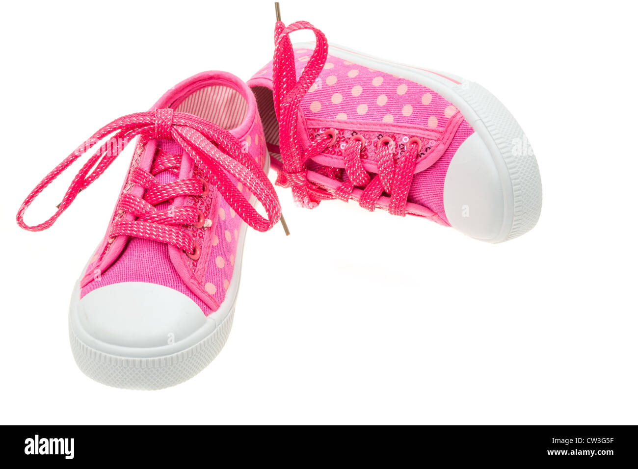 Pink shoes for a little girl - studio shot with a white background - Stock Image