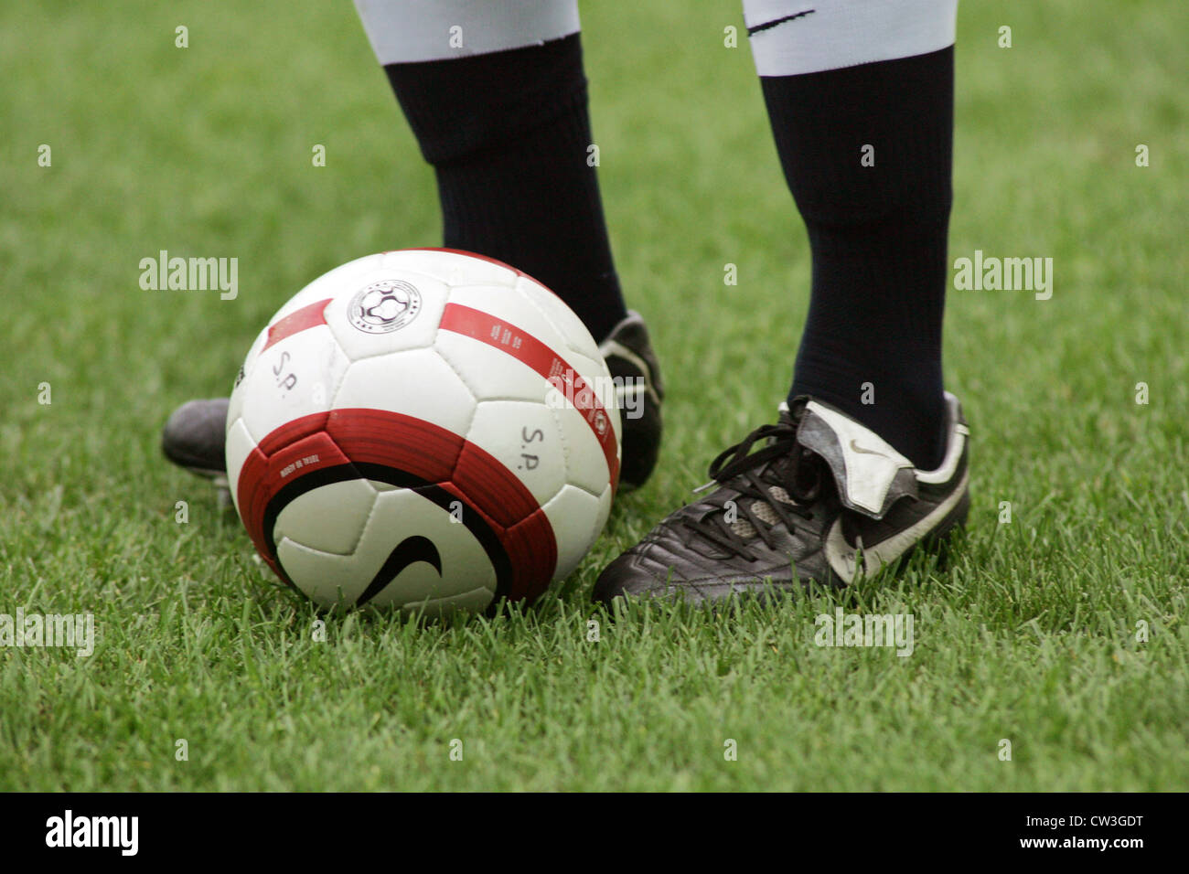 Berlin, close football and footballers legs - Stock Image