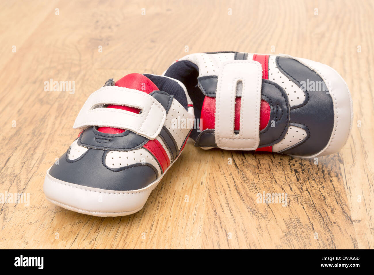 A pair of childs sports shoes - Stock Image