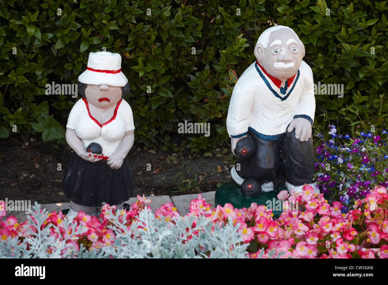 Bowlers Garden Ornaments Positioned In Flower Bed At Bowling Club