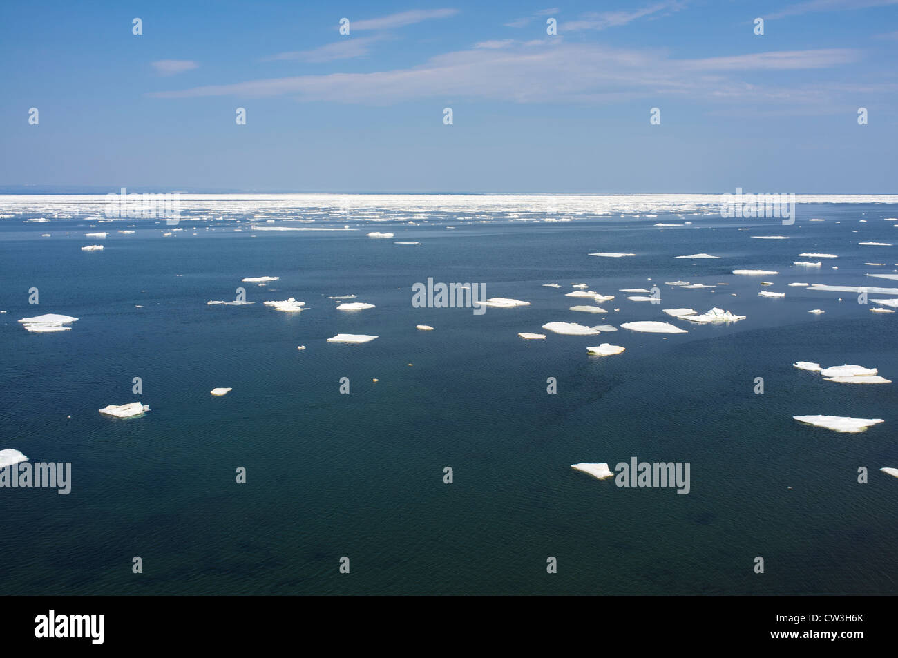The ice pack on the Gulf of St Lawrence breaks up with the warm spring weather - Stock Image