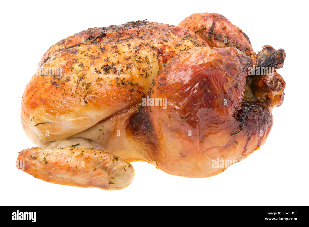 A ready to eat freshly roasted chicken - studio shot with a white background - Stock Image