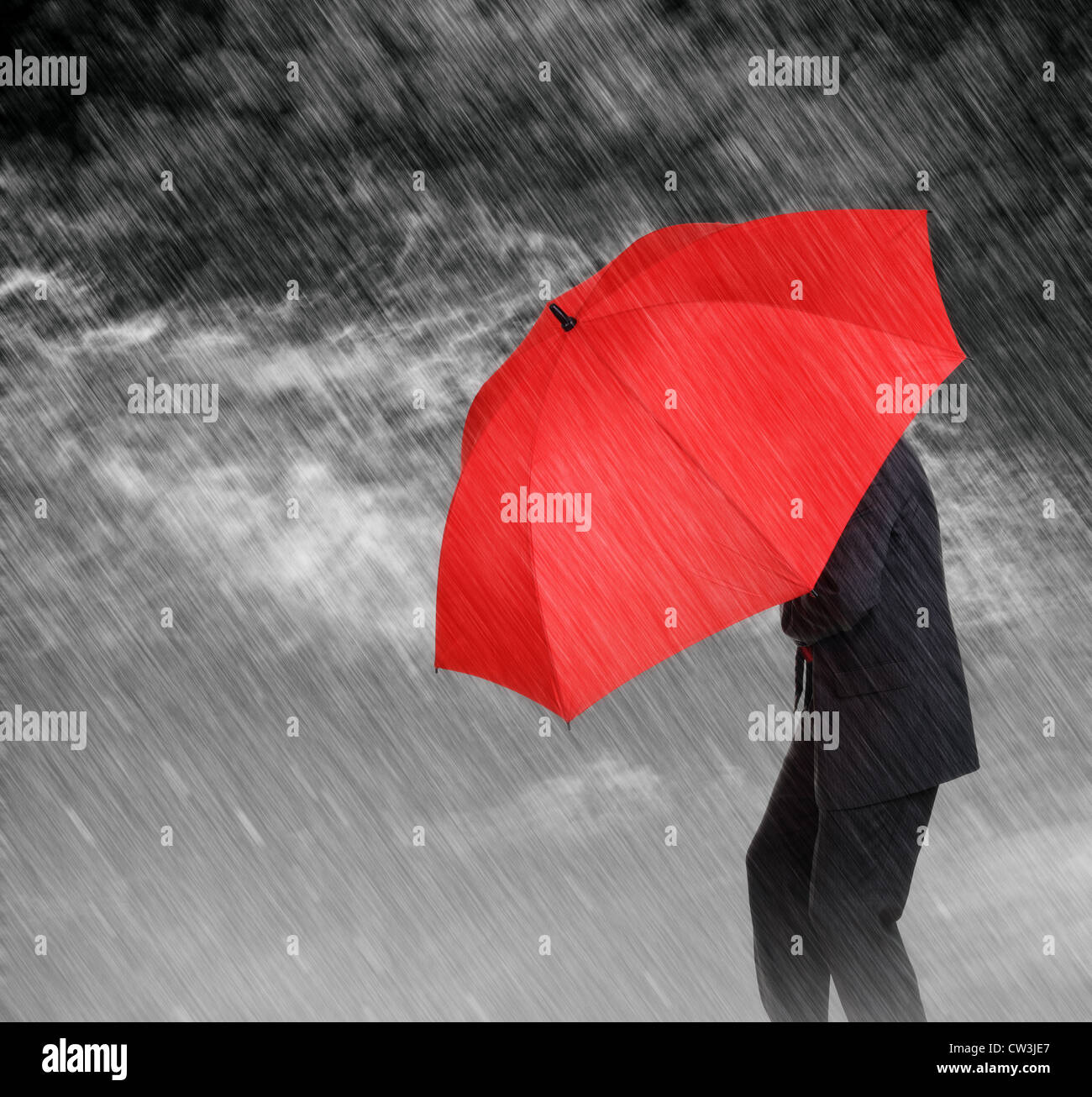 Businessman sheltering - Stock Image