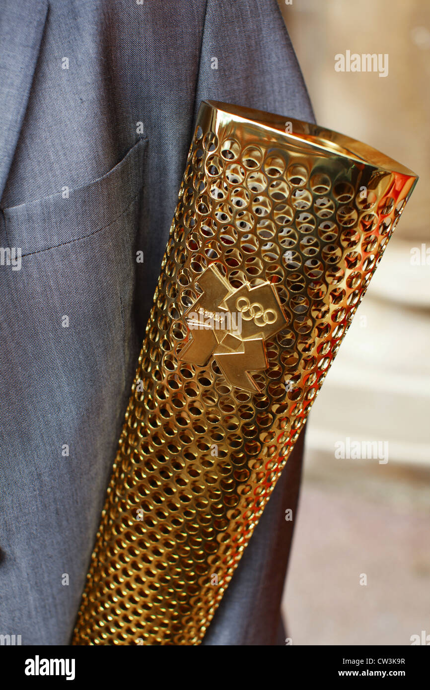 The Olympic torch and a business suit, close up detail to represent cost of the Olympic Games LOCOG sponsors and - Stock Image