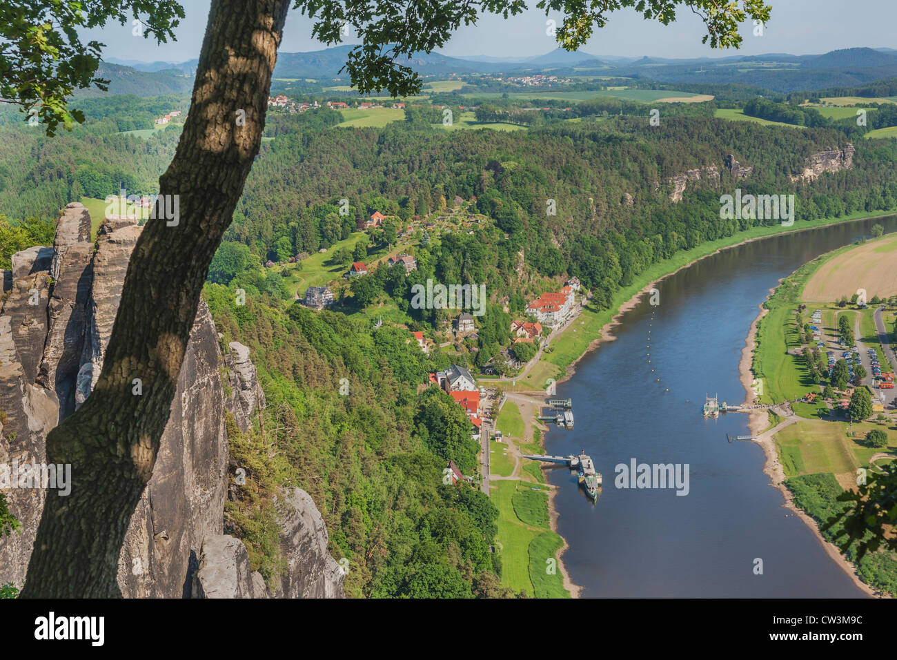 View from the rock formation Bastei (Bastion) to health resort Rathen, near Dresden, and the Elbe River, Saxony, - Stock Image