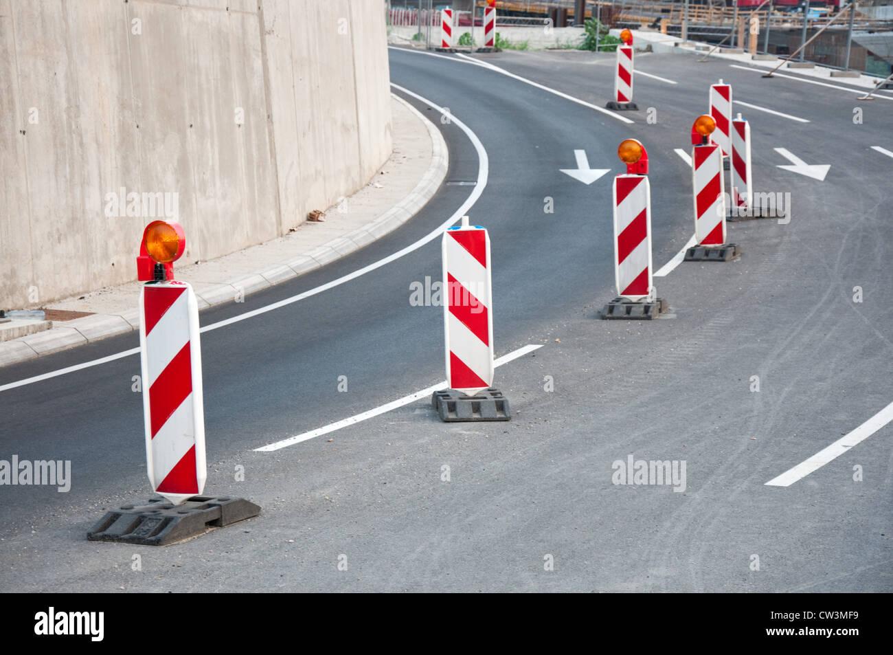 Cautions on asphalt road, common traffic signalization - Stock Image