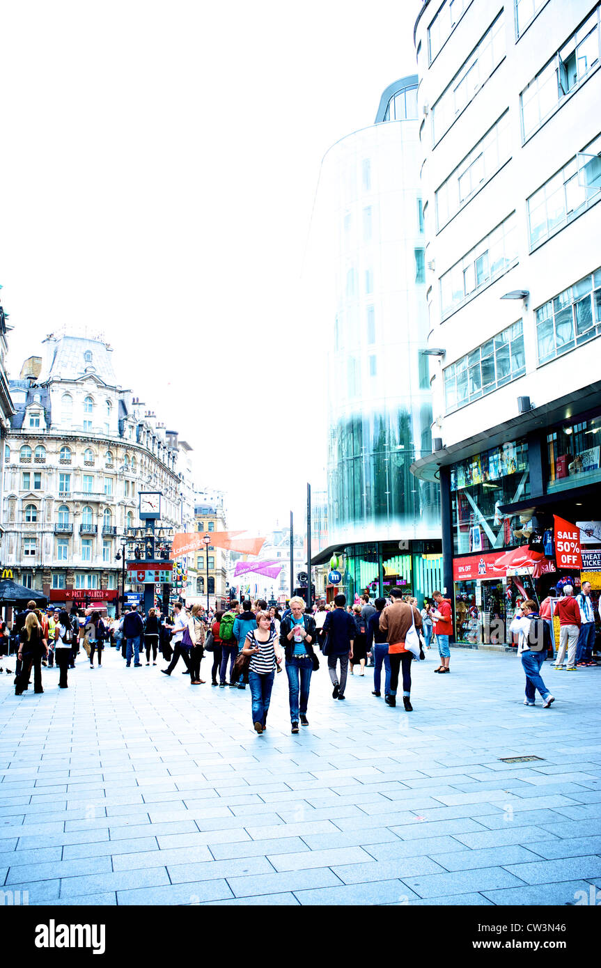 Leicester Square crowds London - Stock Image