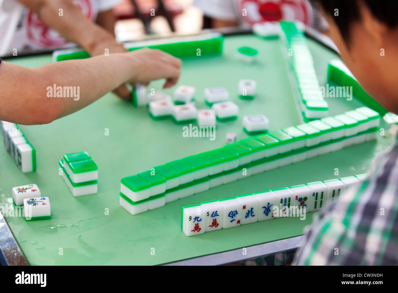 People Playing Chinese Board Game Of Mahjong Stock Photo