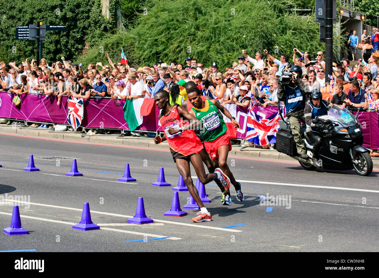 Stephen Kiprotich of Uganda at Tower Hill on his way to winning the Gold Medal in the London 2012 Olympic Marathon - Stock Image