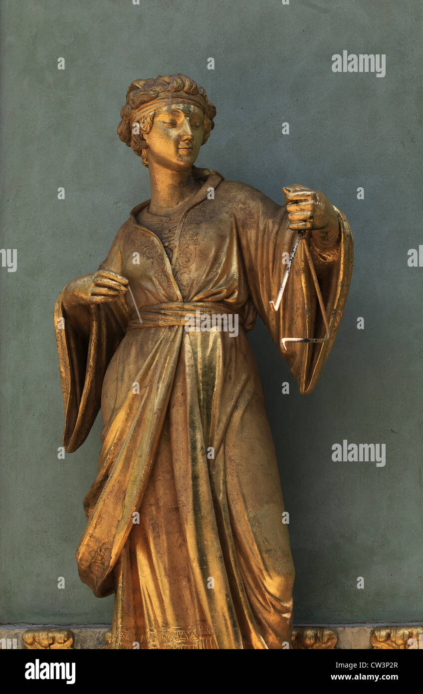 Gilded sculpture of a musician that stands at the walls of the Chinese House,a garden pavilion in the Sanssouci - Stock Image