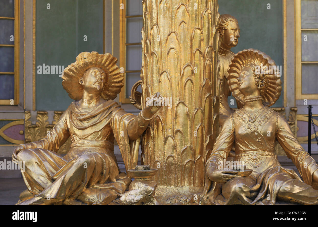 Ensemble of gilded sandstone sculptures of the Chinese House, a garden pavilion in the Sanssouci Park in Potsdam, - Stock Image