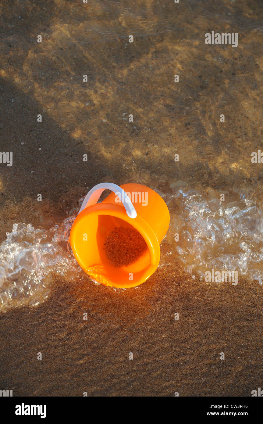 bucket on the sea side - Stock Image