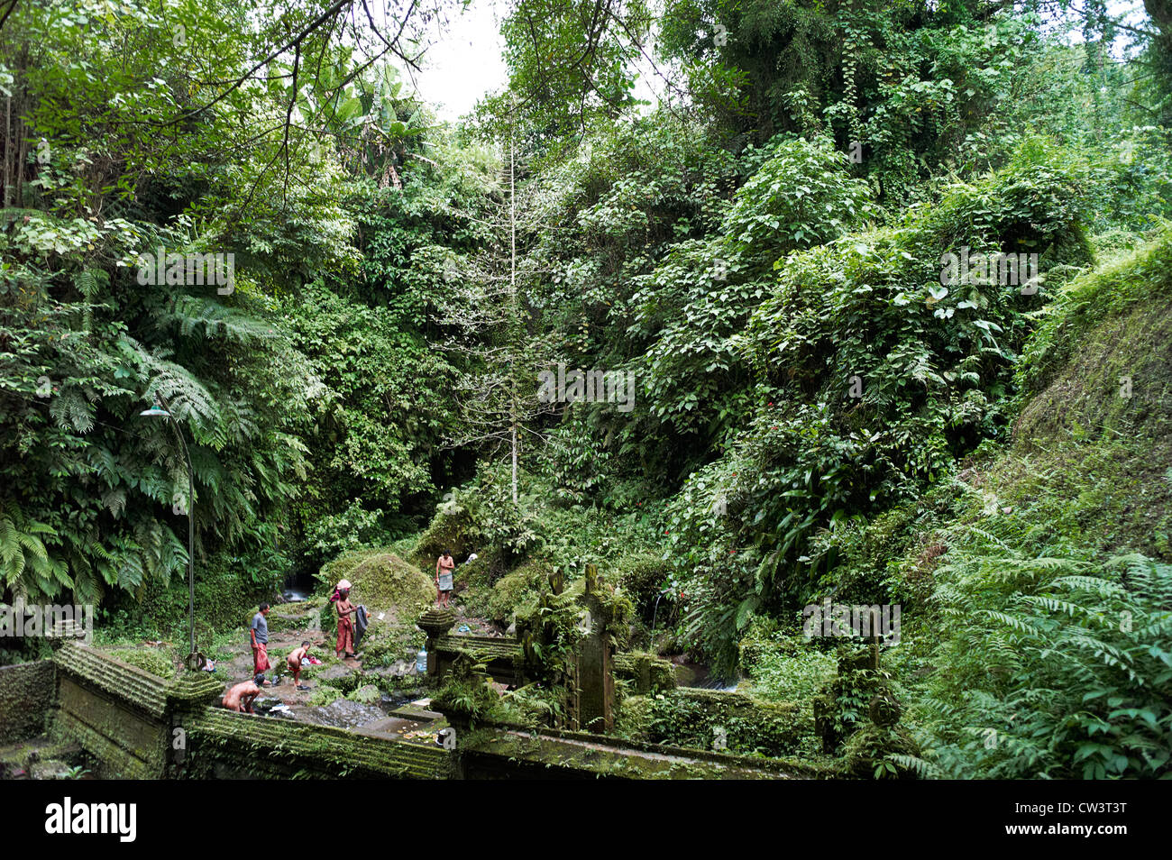 A group of men and boys bathing in the natural springs - Stock Image