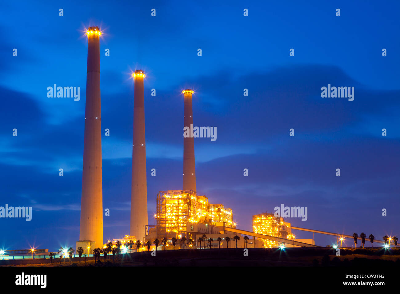 Power plant at night - Stock Image