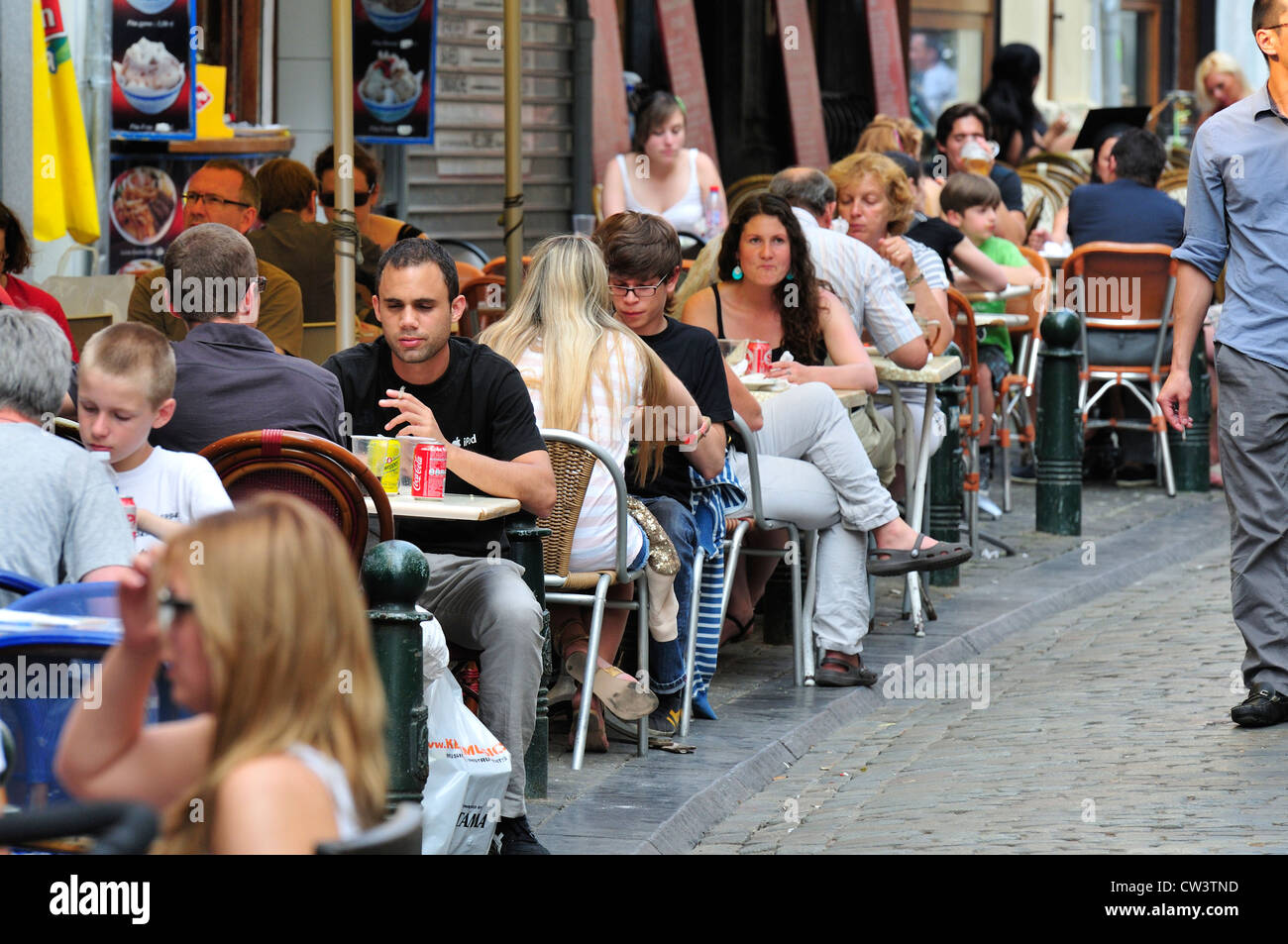 Brussels, Belgium. People at restaurant tables outside ...