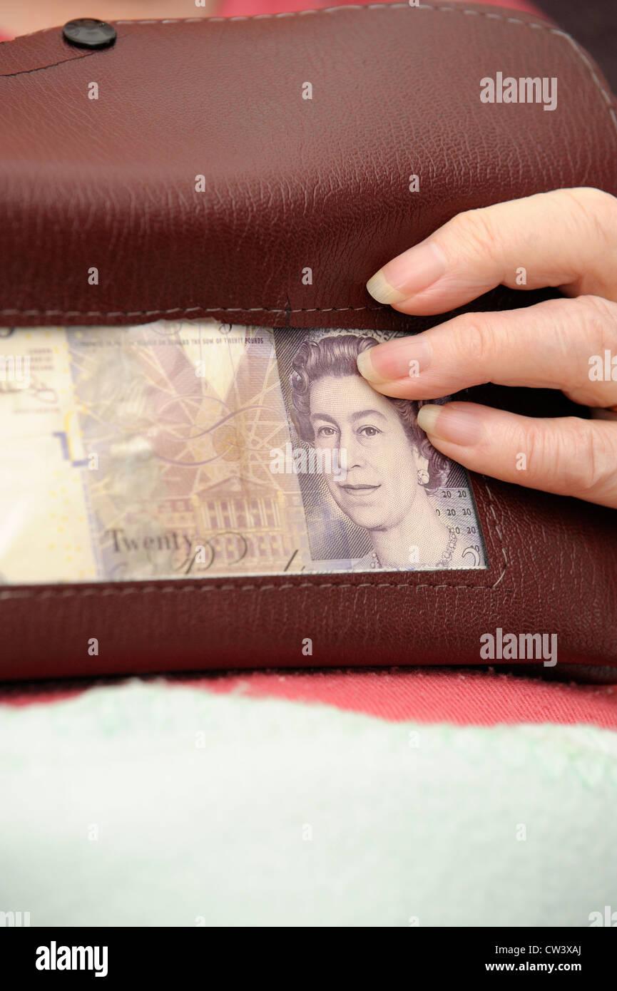 purse with british 20 pound note inside england uk - Stock Image
