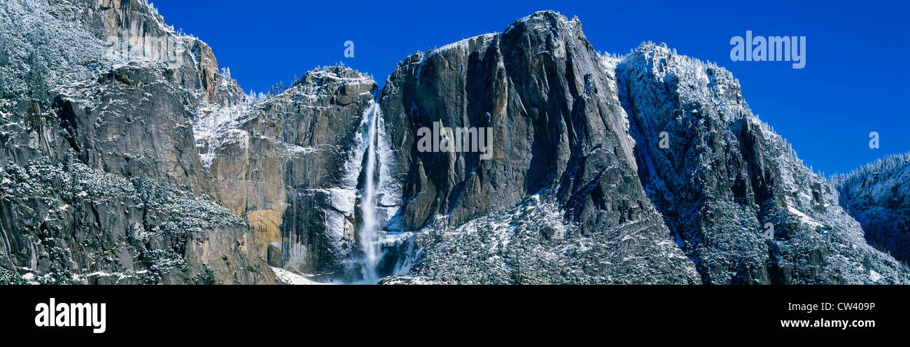 This shows the Bridal Veil Falls during winter. There is a dusting of snow on the surrounding rocks. - Stock Image
