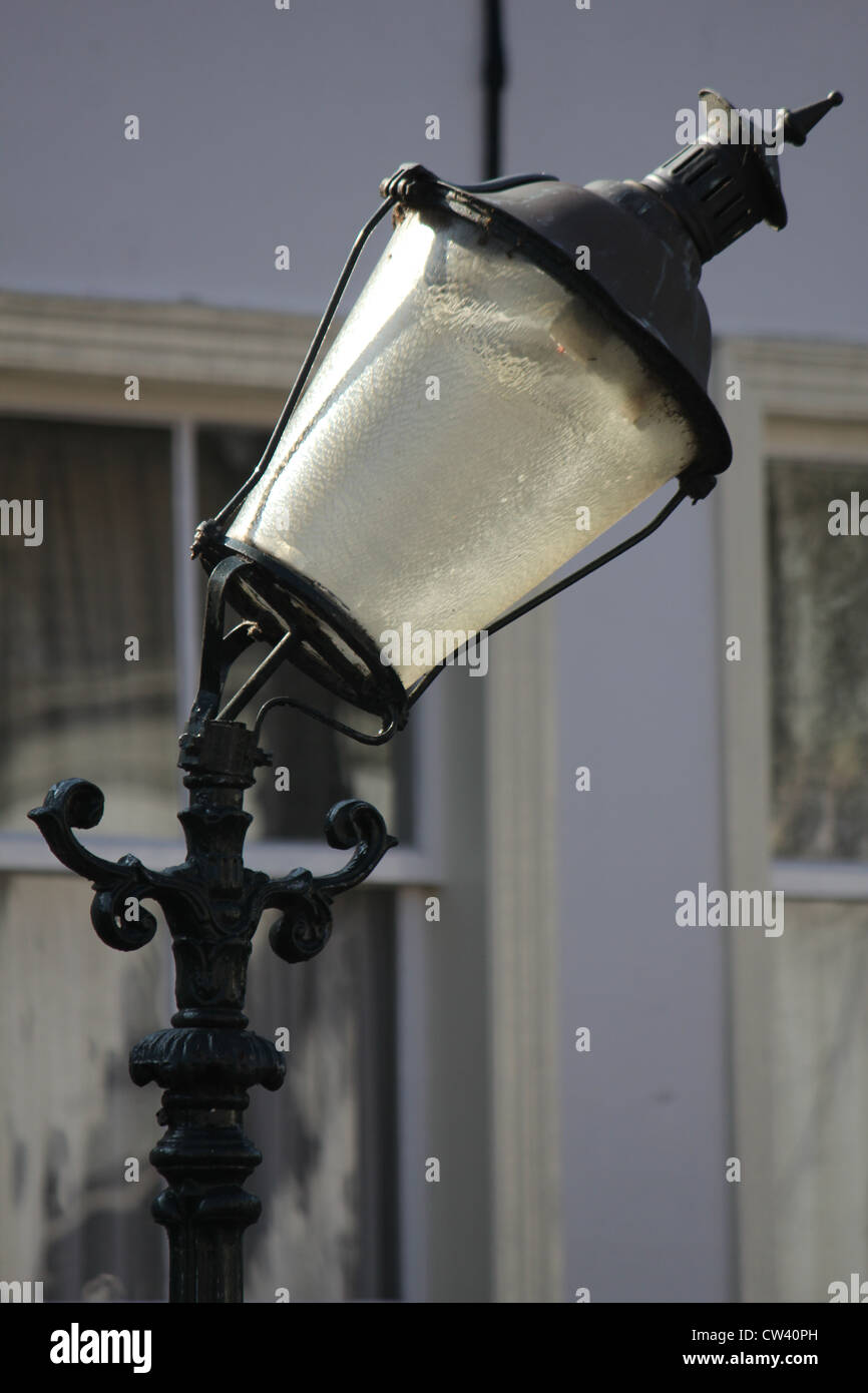 classic old street lantern with a bowed pole - Stock Image