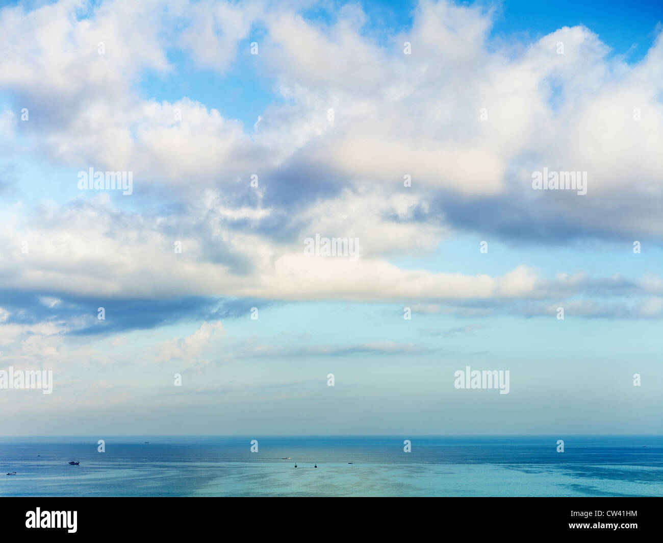 Fluffy clouds over the ocean in Bali, Indonesia. - Stock Image