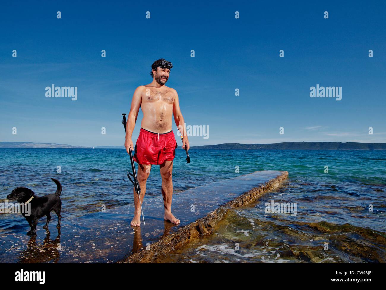 Spear fishing (harpoon fishing) in Dalmatian coast, Croatia. - Stock Image
