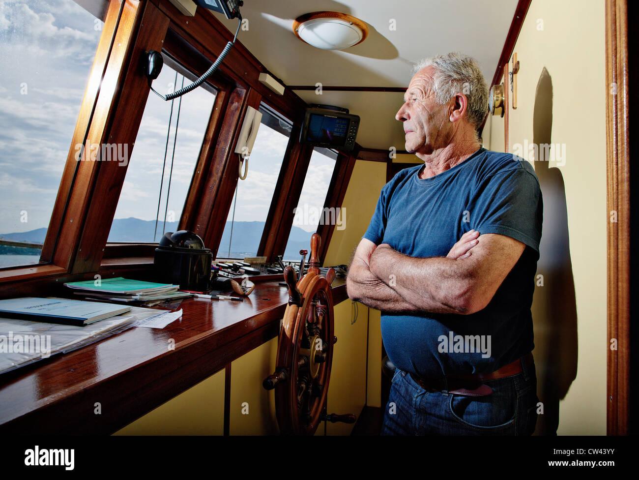 Sea captain sailing along the Dalmatian coast. - Stock Image