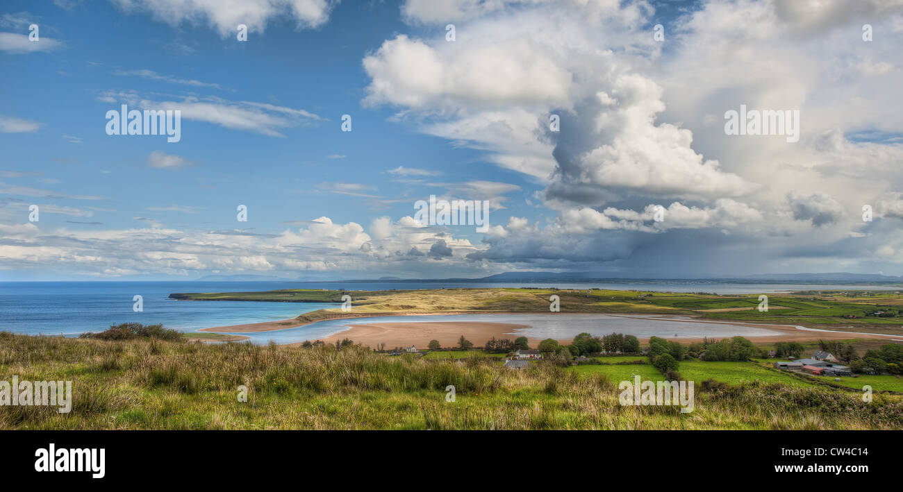 A rain shower falls beyond Lacken Strand on a summer day in County Mayo on the west coast of Ireland. - Stock Image