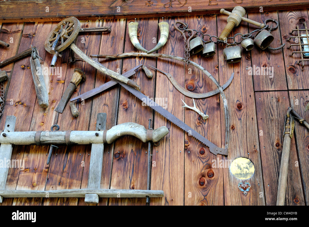 Old Woodworking Tools And Farming Implements Fixed To The Side Of A
