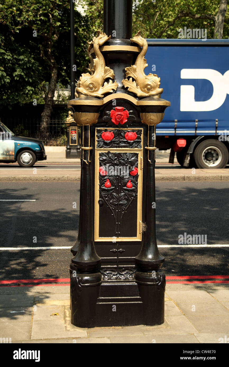 Detail from a decorative lamp post, known as a 'dolphin lamp standard', on the Victoria Embankment in London, - Stock Image